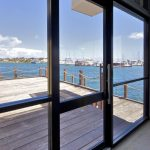 Glass doors for establishment by the sea