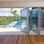 Multi-fold glass walls on poolside