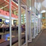 Multi-fold glass doors for commercial establishment