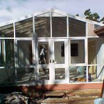 Sunroom with glass and awnings installation
